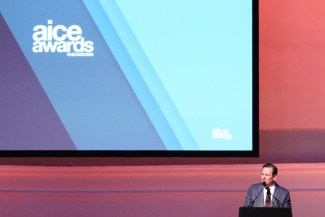 Tom Duff onstage at the 2016 AICE Awards