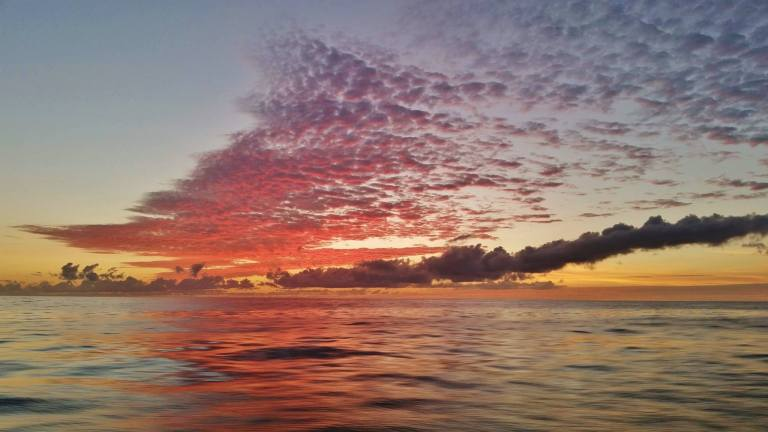 Smoke on the water? Not really... just an beautiful sunset with different types of clouds. Captured last evening while headed in from an offshore fishing trip.