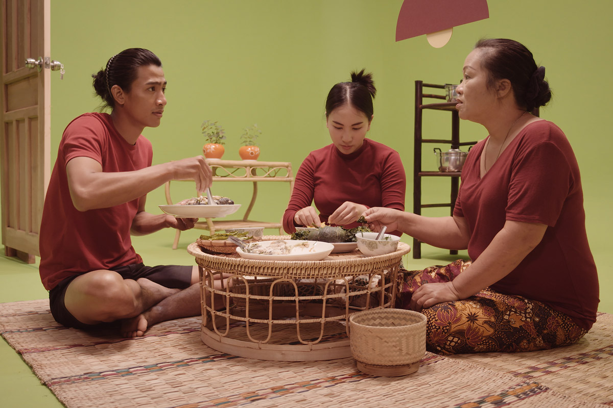 A Laos family eating together on a film set