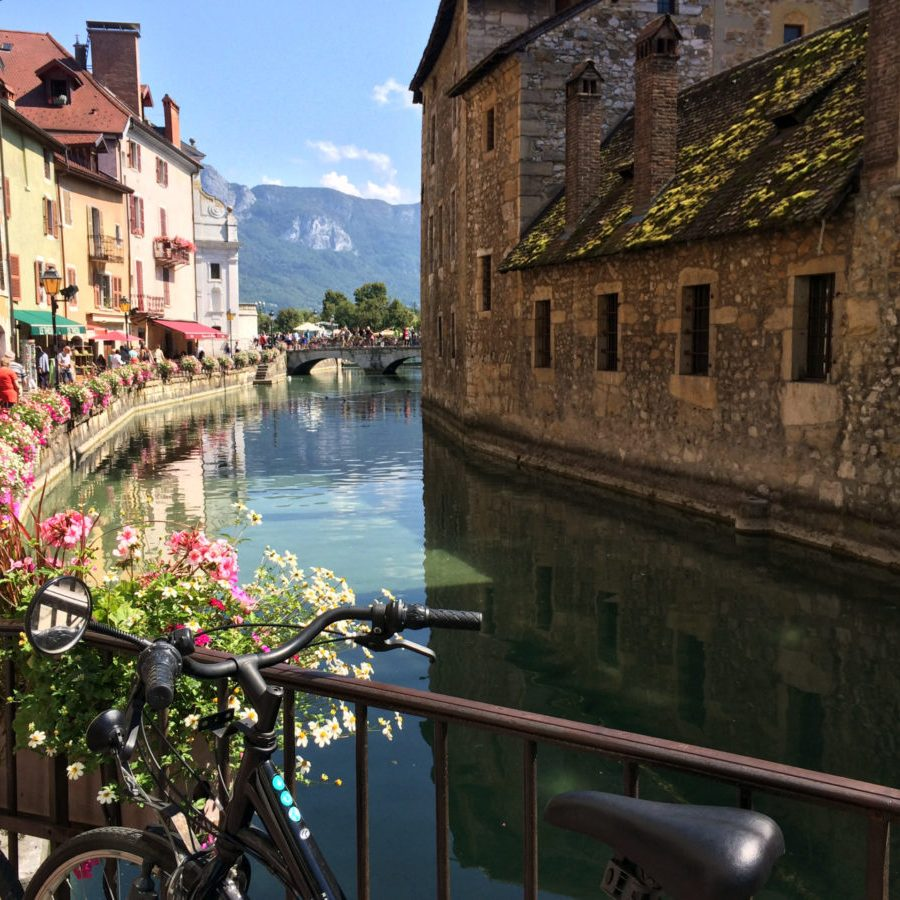 bike leaning on a bridge in Annecy near the old prison