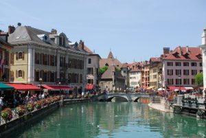 Annecy le Vieux canal and old prison on a sunny day