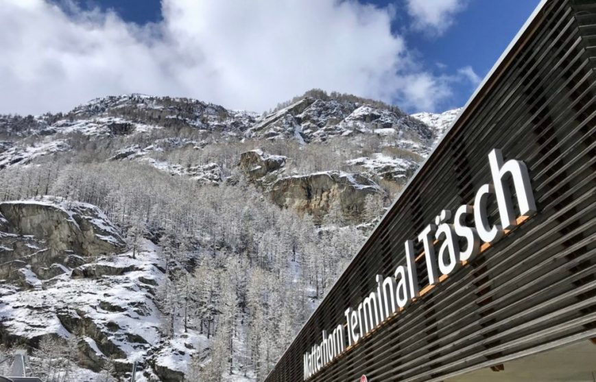 Tasch train station and snowy mountain