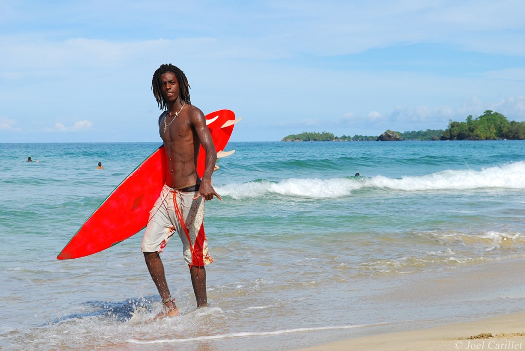 Surfer on Isla Bastimentos in Bocas del Toro, Panama