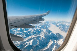 Snow-covered Alps from airplane window