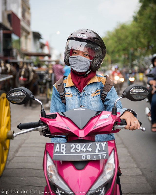 Woman on motorbike in Yogyakarta, Indonesia