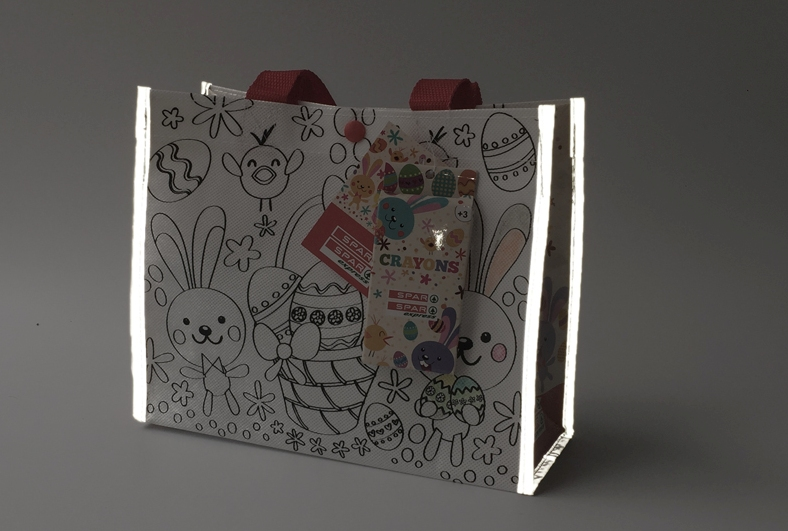 Spar Introduces Coloring Shopping Bag with Reflective Sides