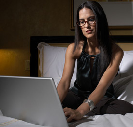 woman laptop sitting down chiropractic online consultation