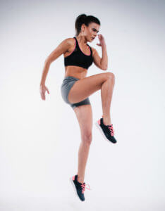 woman running on spot with gluteal muscles glutes
