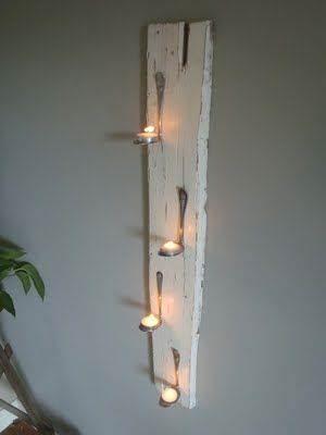 Iluminación con tablas de madera reciclada