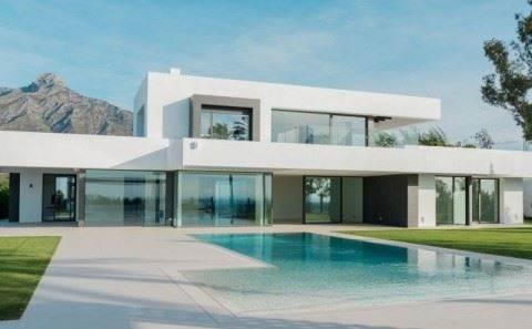 Fachada estilo contemporaneo y piscina