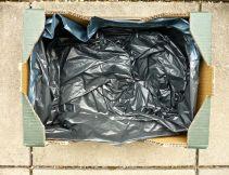 Man nehme zur Erstaufnahme einen Obstkarton und kleide ihn mit einem Müllsack aus