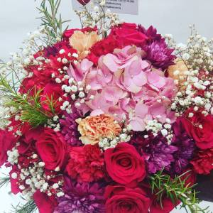 pink hydrangeas, red and peach carnations, purple chrysanthemums and million star (gypsophilia) flowers.