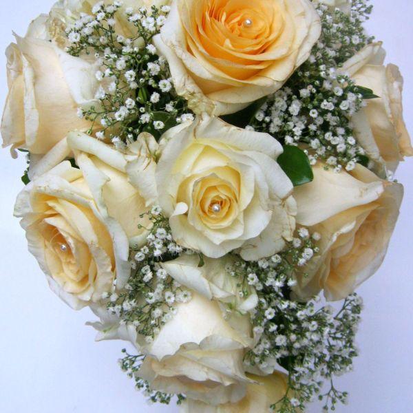 Cascading bridal bouquet 003 cream del la cream roses