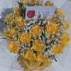 Rich arrangement of yellow roses, and million star