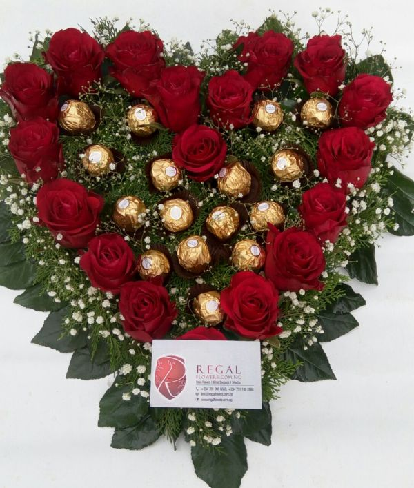 Fresh Roses interlaced with luxurious Ferrero Rocher chocolates with greens and other flowers