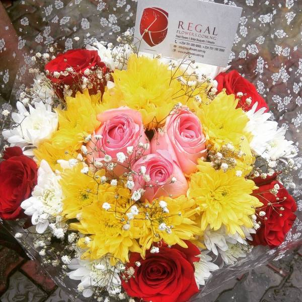 Signature combination of roses, million stars, red and yellow chrysanthemums.. . . Order on the website: www.regalflowers.com.ng now, or call 07011992888, 07010006665 to order. .