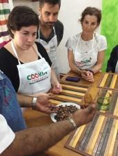 Husking cocoa beans