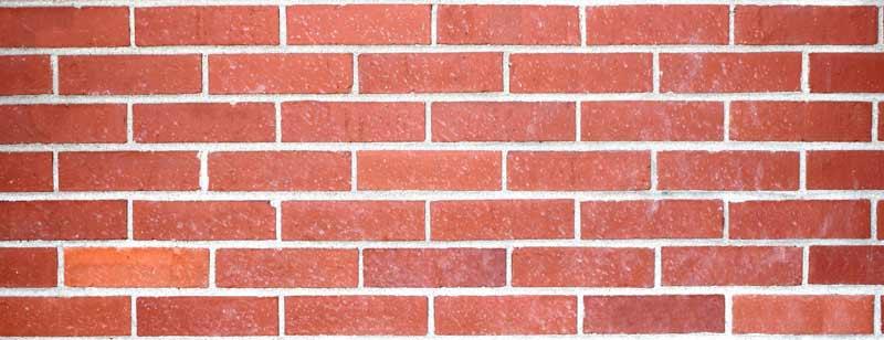 Photographie d'un mur de briques