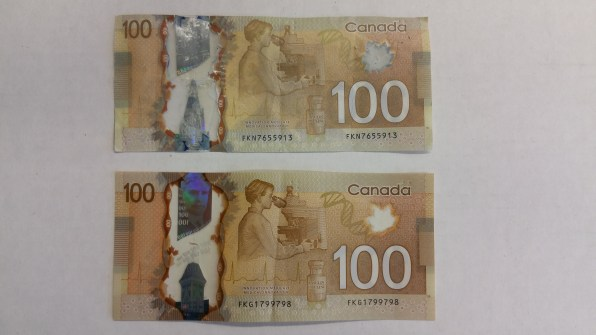 The real bill (bottom) is smooth and consistent throughout, where as the transparent window in the fake bill (top) is inconsistent and bumps and ridges are visible on close inspection.