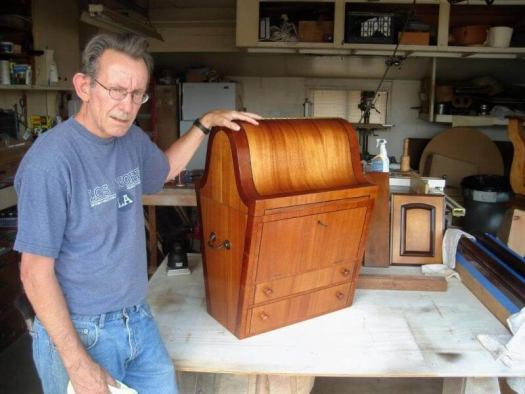man holding a wooden treasure chest