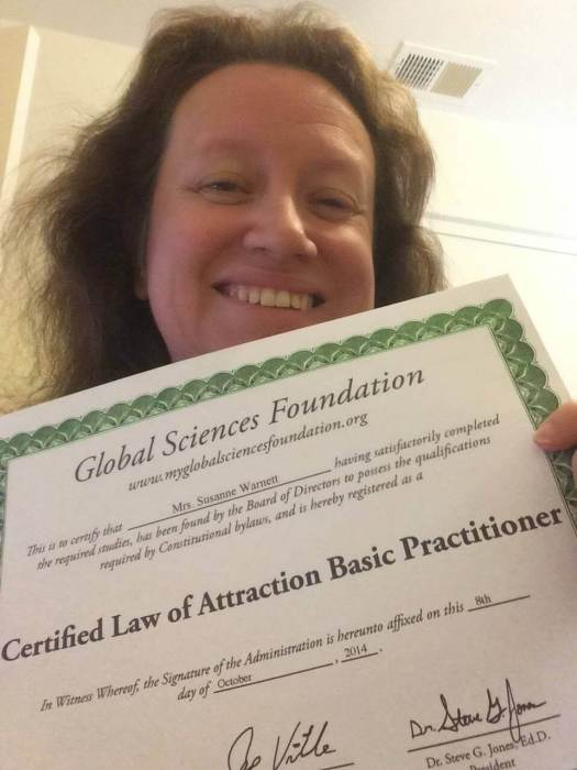 woman holding law of attraction certification