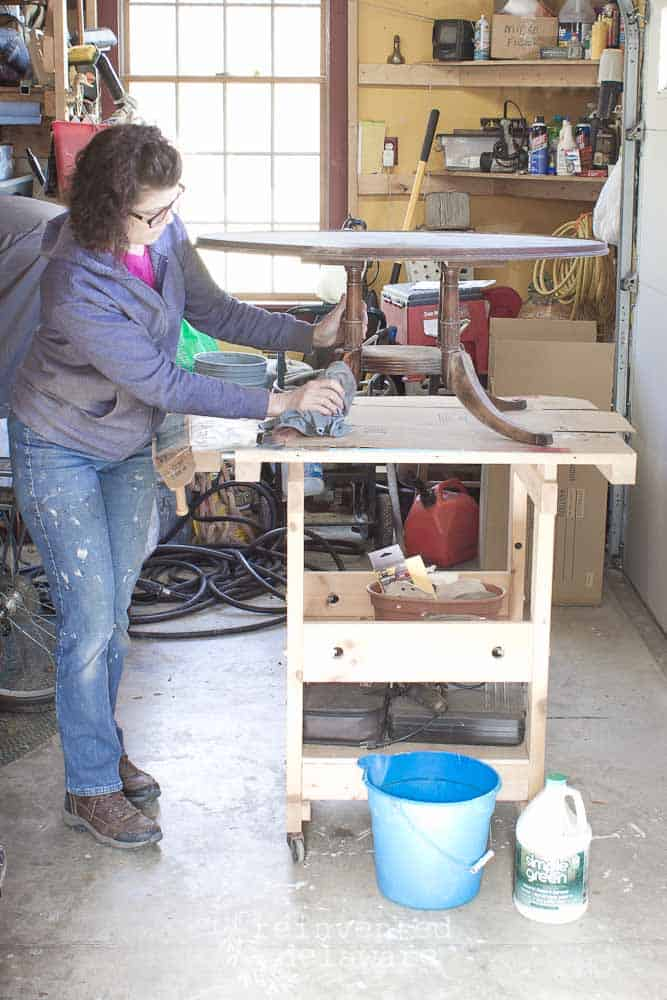 lady washing a dirty vintage coffee table with Simple Green
