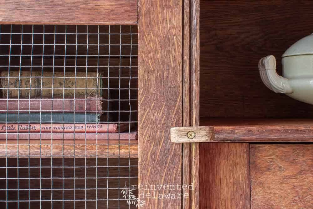 secretary desk close up of handmade door closure