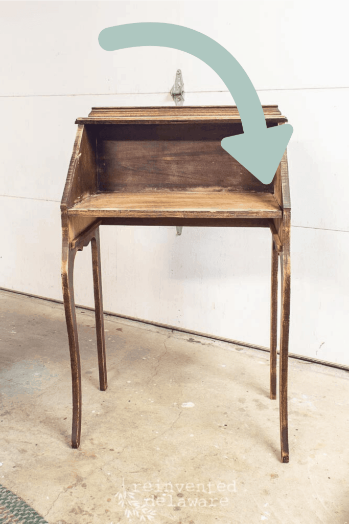 fold down secretary desk with graphic arrow showing repair
