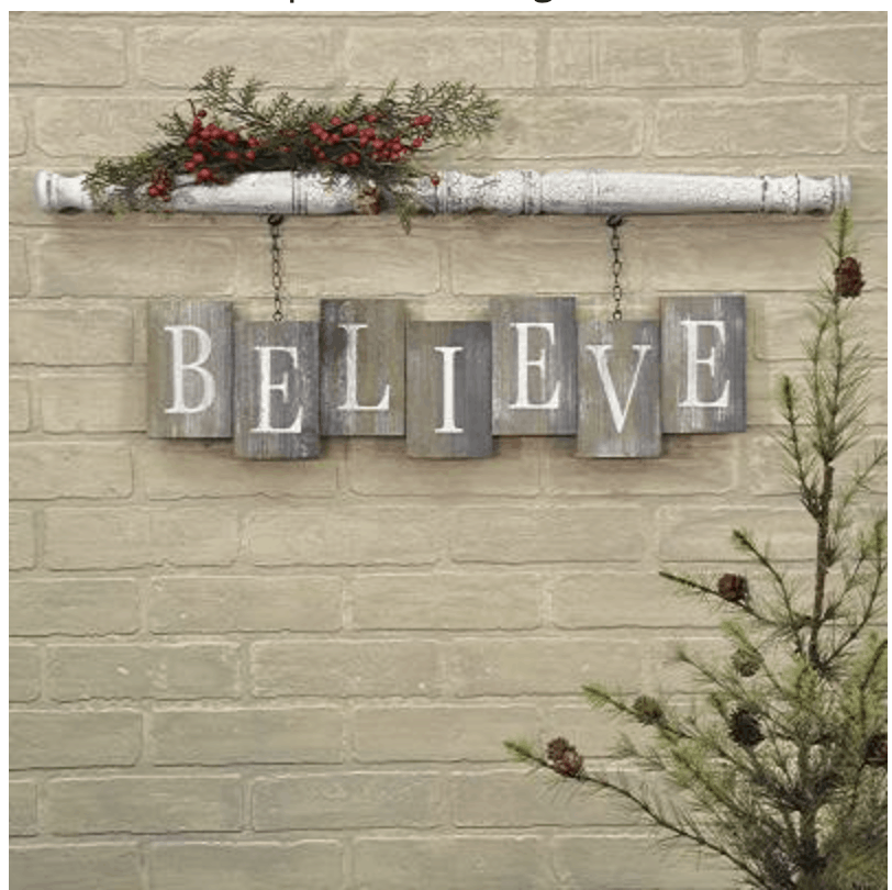 spindle hanging sign with believe painted on