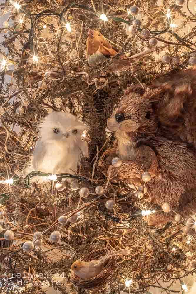 close up of woodland critter Christmas tree ornaments - an owl and a squirrel