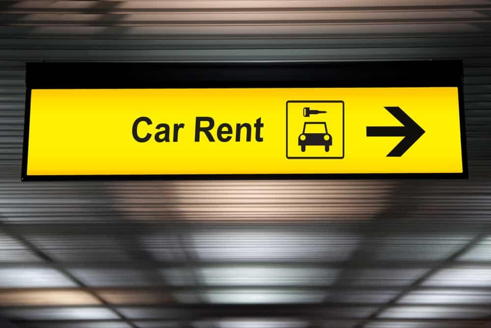 """Skilt til biludlejning med teksten """"Car Rent"""""""