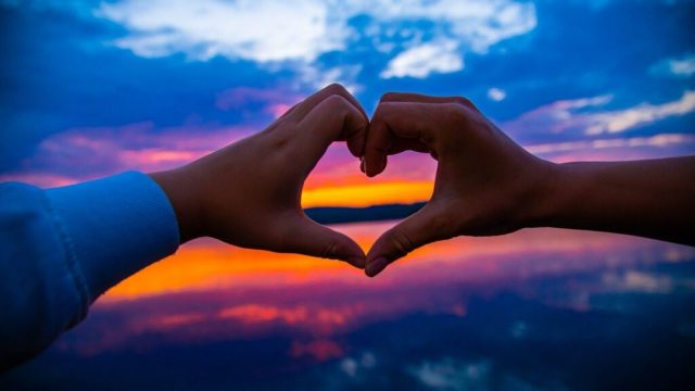 Heart, hands, sunset - travel