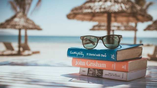 travel book sunglasses beach