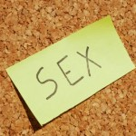 the word Sex handwritten on a yellow post-it note