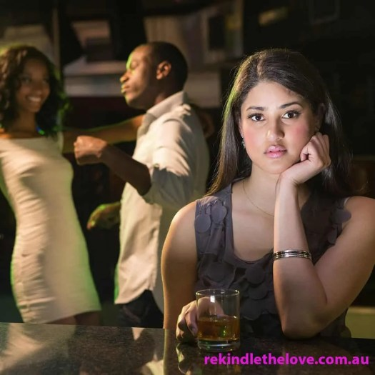 unhappy woman with couple behind her