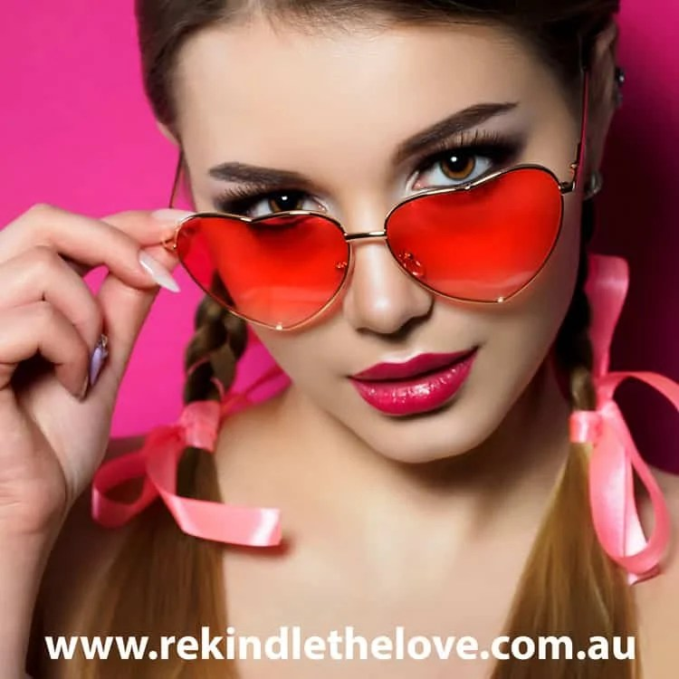 woman with heart-shaped rose-tinted glasses
