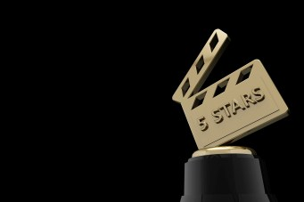 Gold movie film slate trophy with the word 5 stars on the front