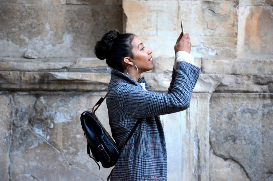 Woman, taking a selfie instead of calling the man she is dating