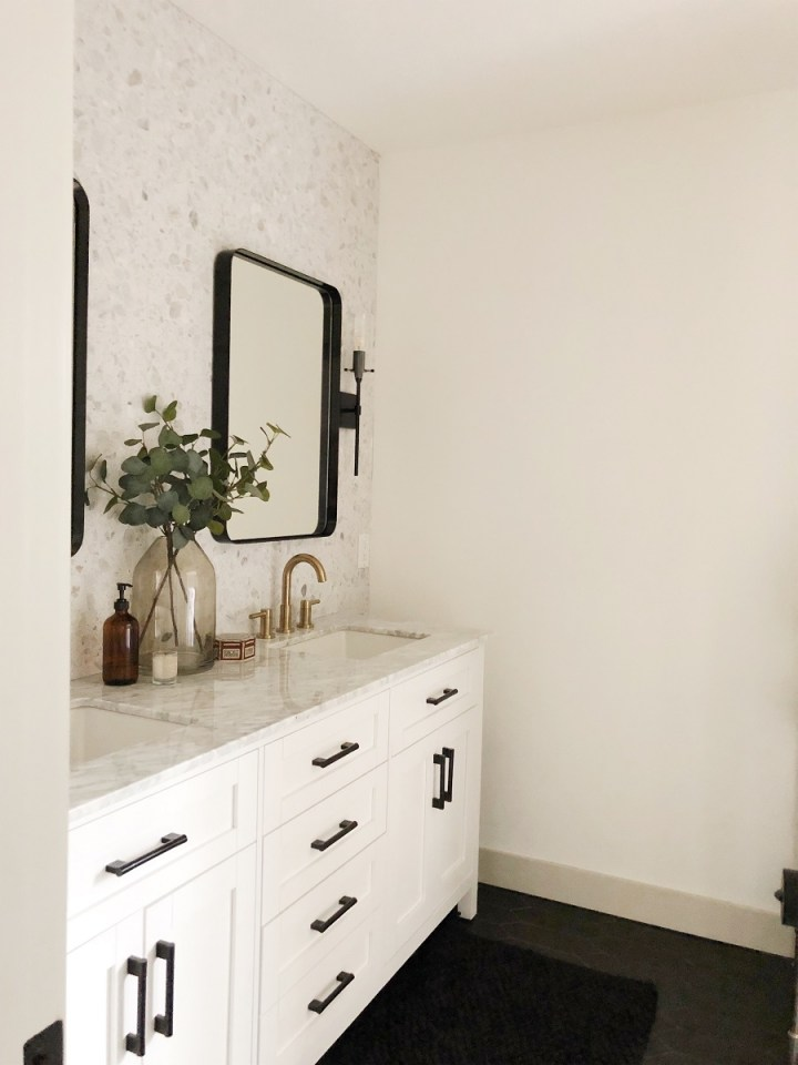 """72"""" Bathroom vanity with two rounded mirrors. Black and gold accents used throughout. Floor to ceiling Terrazo Tile Backsplash."""