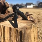 Image of The XT6TR sitting on a chunk of wood with a blurred out background
