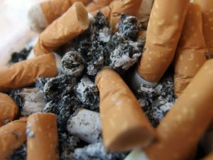 Cigarette Butts in Ashtray 300x225 Quit smoking