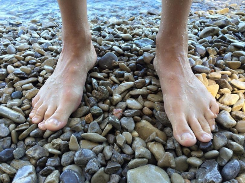 Have your bare feet make contact with the ground