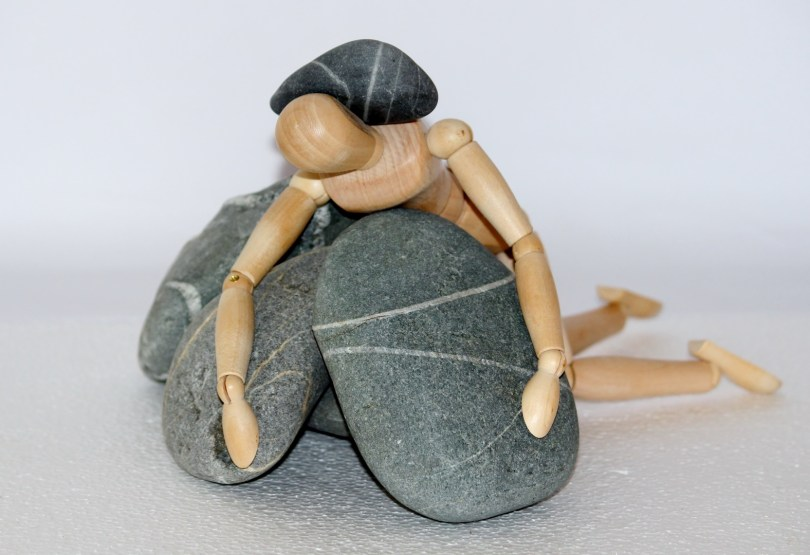 Rocks on a artist dummy, to show the weight of not being good enough.