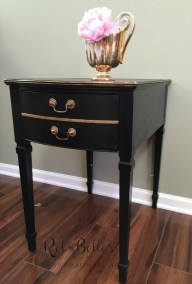 Black side table with gold highlights - Side view