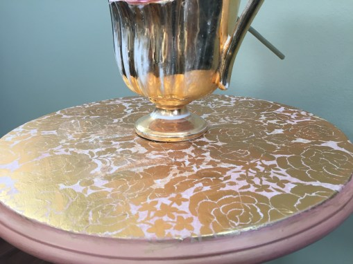 Coral round table with decoupaged top with gold roses