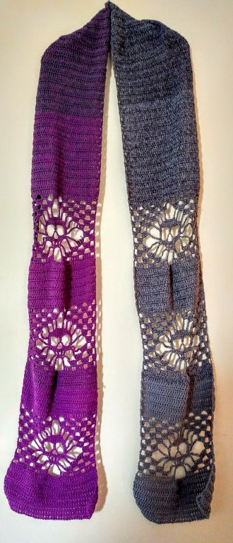 Skull Scarf - Free Pattern  Purple to grey crocheted skull scarf. Each side has 3 skulls broken up with blocks of double croche