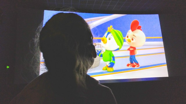 Izzy watching  an episode of top wing