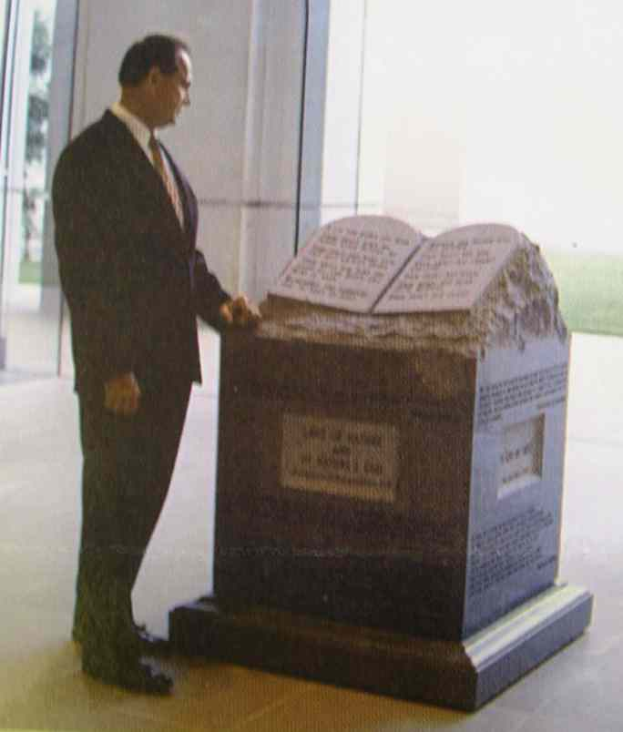 Alabama Chief Justice Roy Moore and the Ten Commandments Monument at the Alabama Judiciary Building