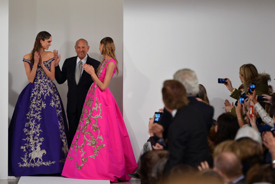 Oscar De La Renta is one of my favorite designers.  His Spring 2014 line was absolutely stunning this year.  He brought back lady-like gloves in part of his collection which I was excited to see.  He also designed these two stunning gowns.  The pink one is my favorite because the color is so vibrant.