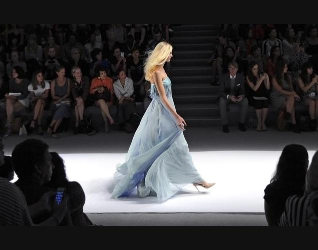 A model presents a creation from the Spring 2014 collection by Tadashi Shoji during Mercedes-Benz Fashion Week in New York.  I love the whimsical look of this dress and the color is so beautiful